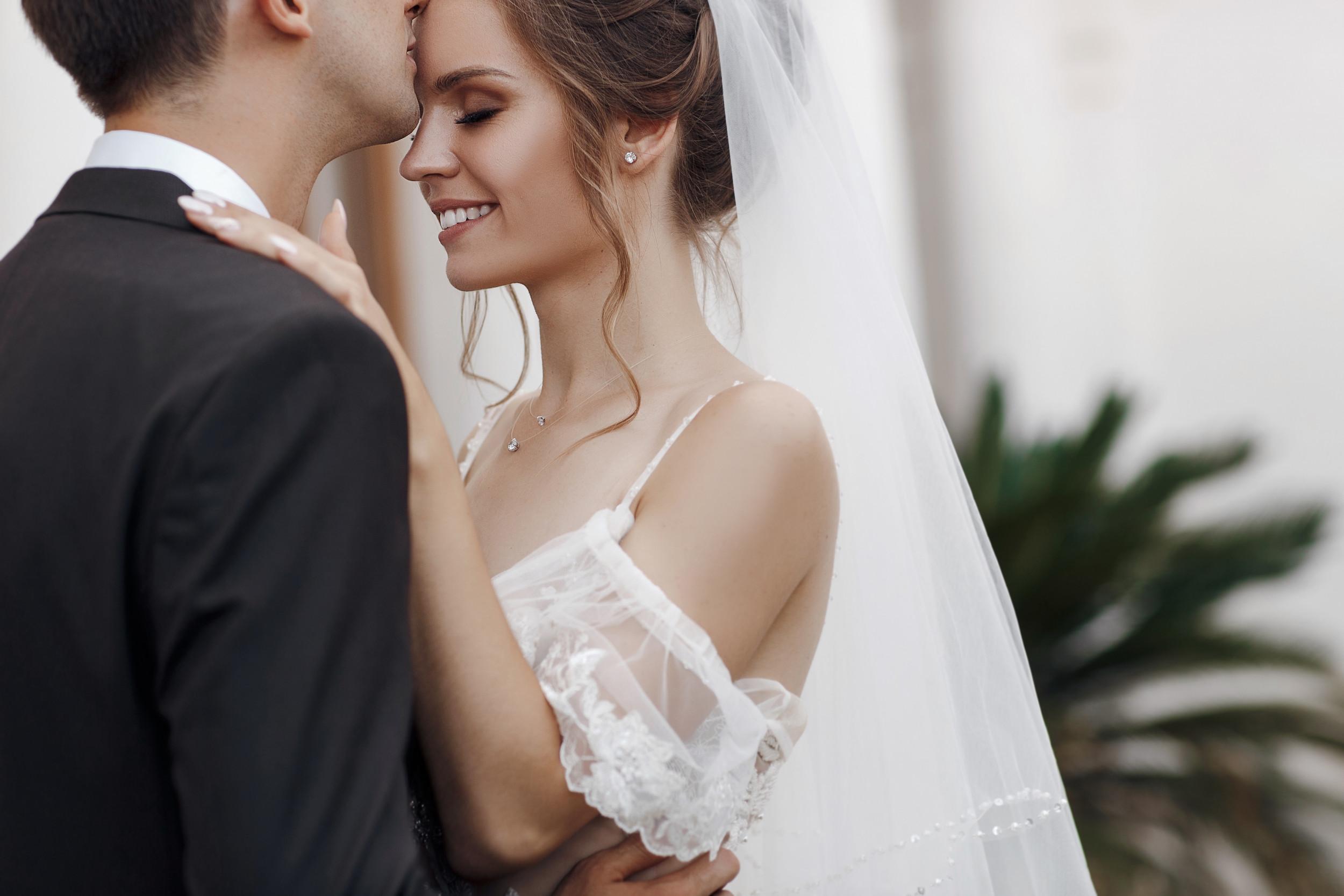 Man Hides Under Bride's Wedding Dress to Help Her Walk Amid Strong ...