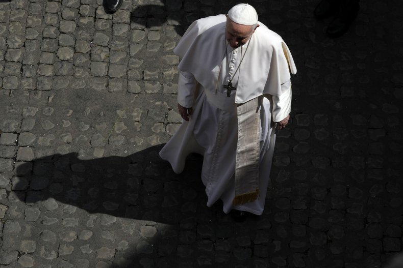 Pope Francis walks during the audience