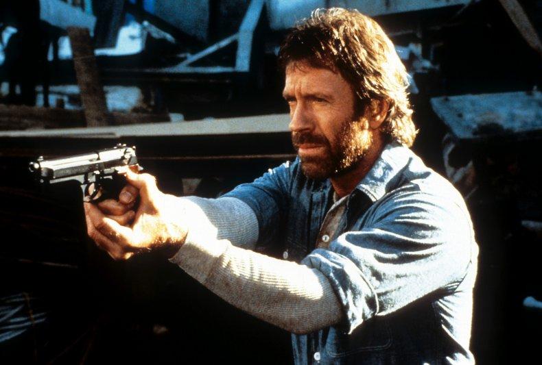 Chuck Norris points a gun