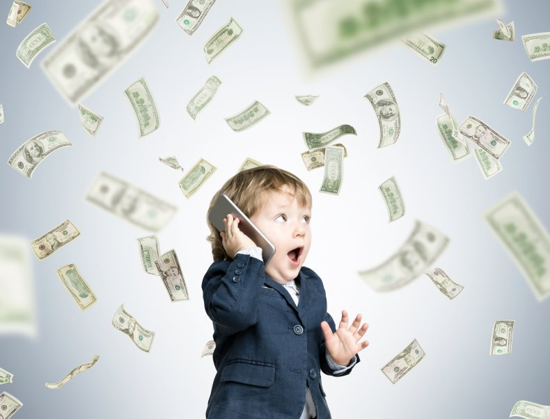 Young boy surrounded by money