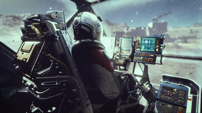 An Astronaut Sits at a Control Panel