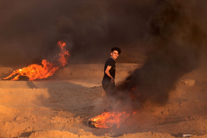Palestinian Protester Sets Tires on Fire