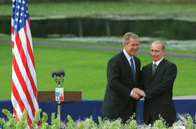 George W. Bush Shakes Hands with Putin