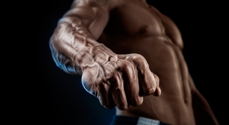 A bodybuilder shows off his muscles.
