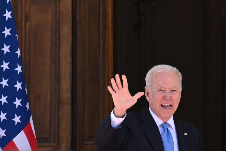 President Joe Biden waves at press