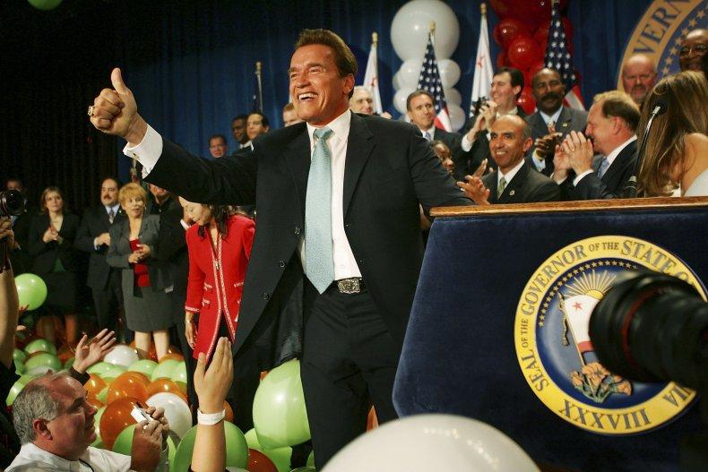 Arnold Schwarzenegger celebrates victory