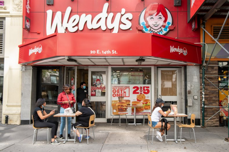 Customers eating at Wendy's.