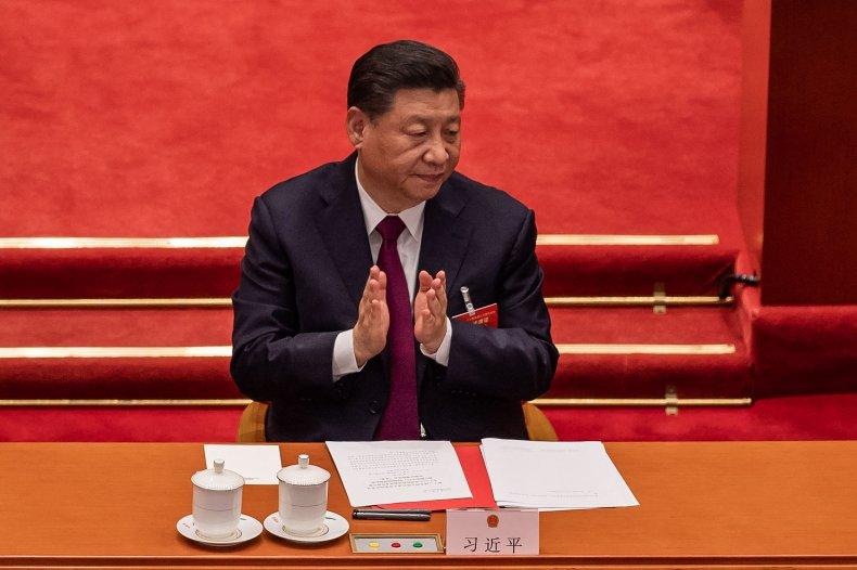 China's President Xi Jinping applauds