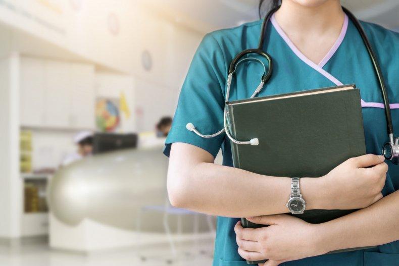 Nurse holding files