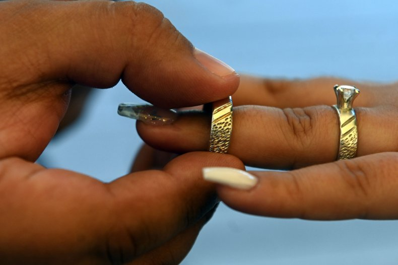 Two people marry in San Salvador.