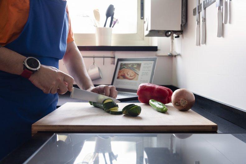 Man chopping veggies