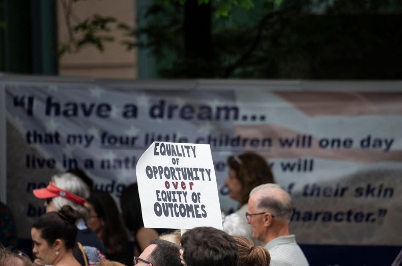 A participant holds up a sign during