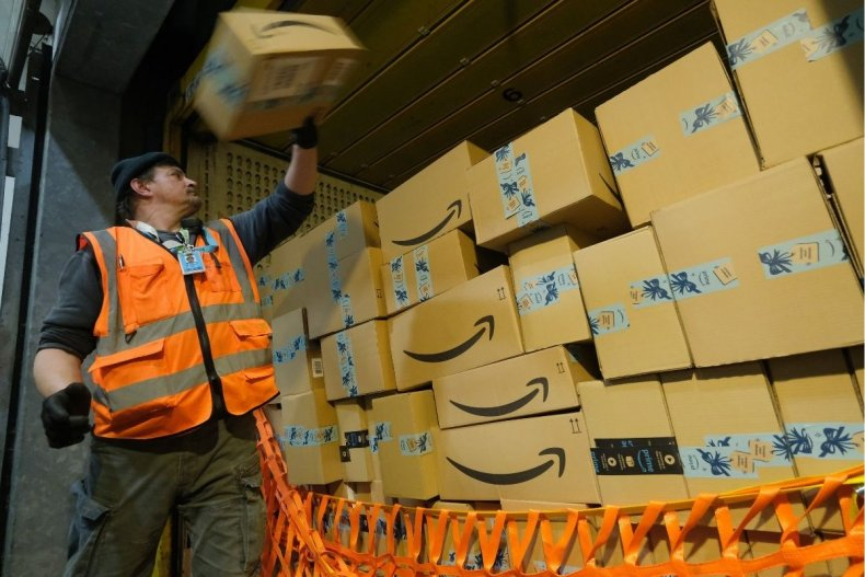 Worker loading Amazon van in Germany