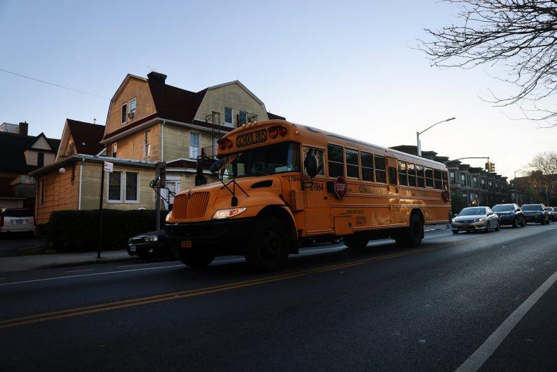 A school bus drives through Brooklyn.