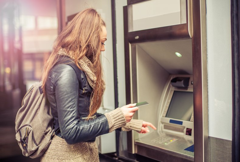 Young woman using an ATM.