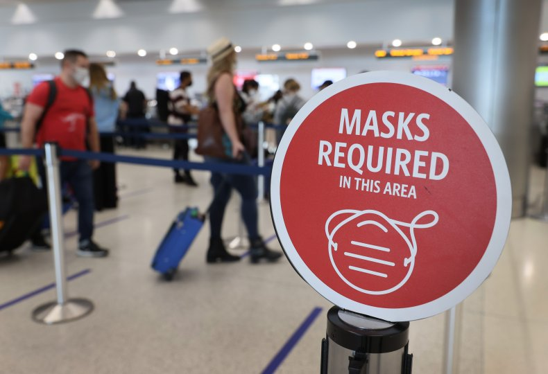 A mask sign at Miami International Airport.