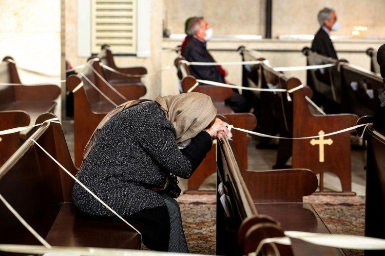 A woman prays at the Saint Sarkis