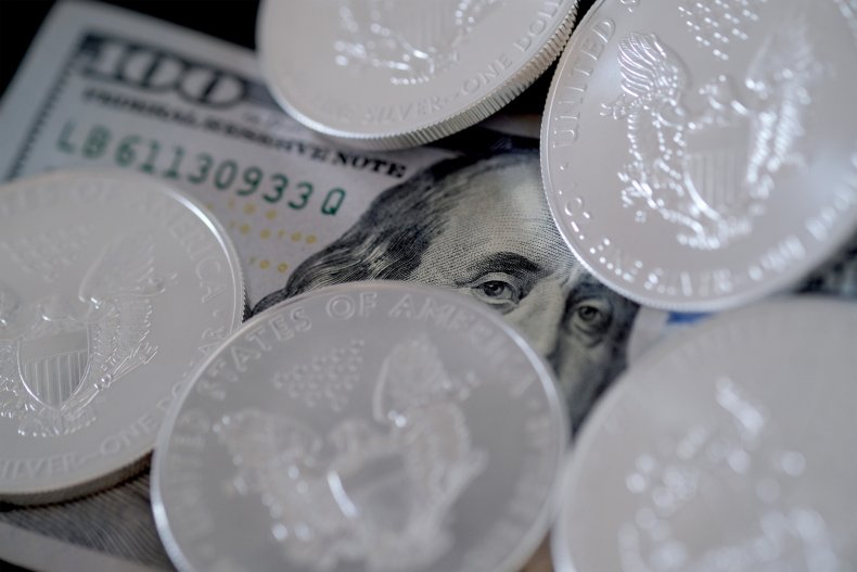 Coins and a $100 bill are shown