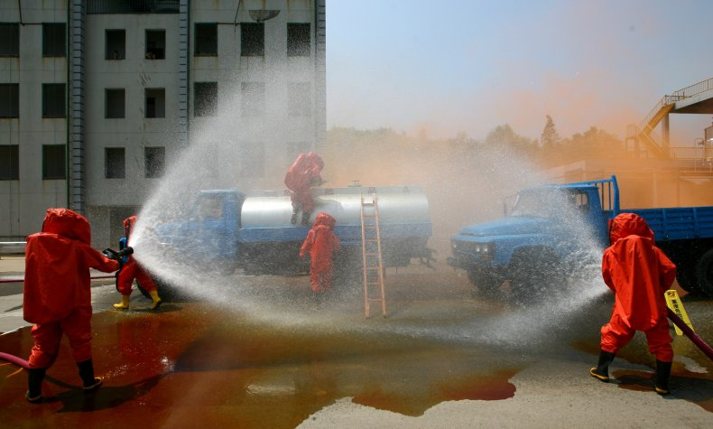 Chinese Firemen In Chemical Hazard Drill