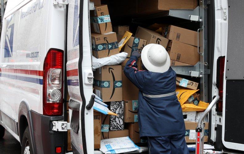 U.S. Postal Service worker unpacks packages