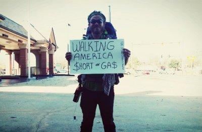Jake Sansing with sign during walk