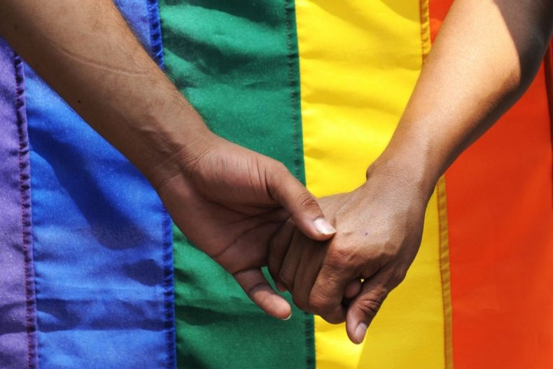 File photo of LGBT flag with hands