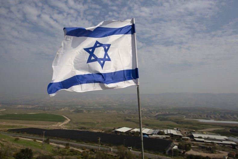 An Israeli flag flies in a Jordan