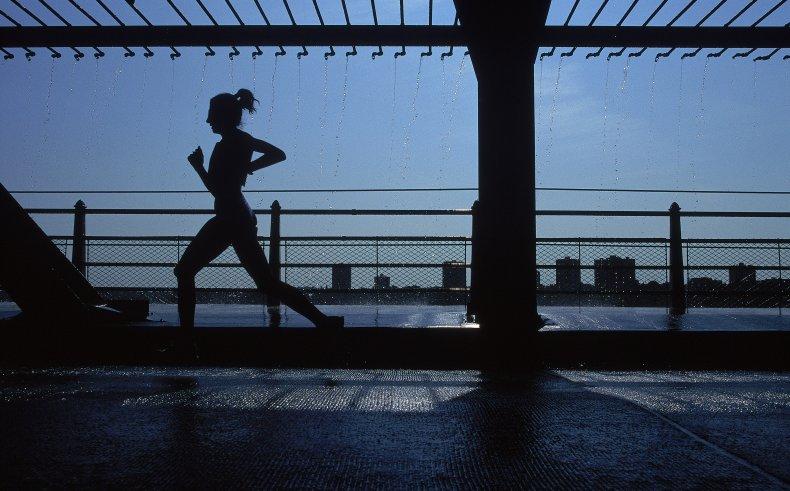 A silhouette of a women running
