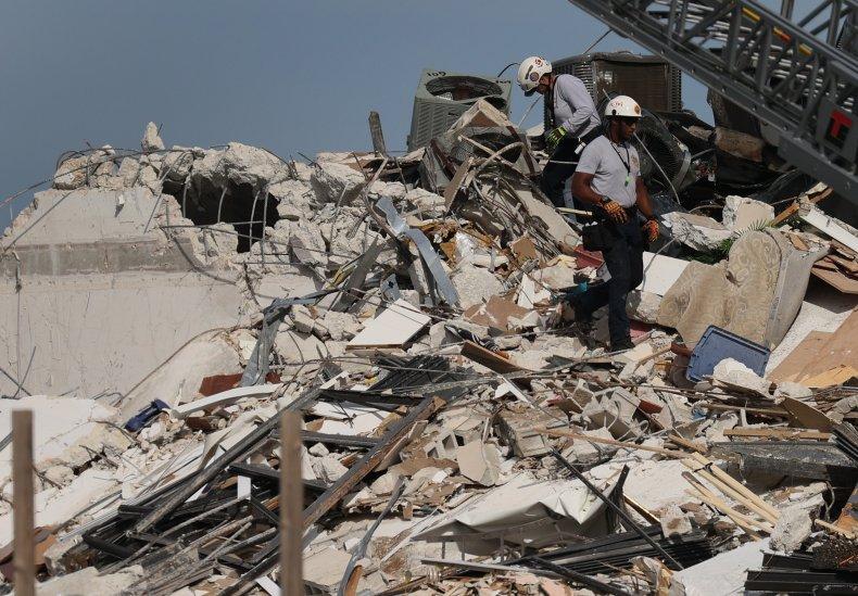 Miami-Dade Fire Rescue Personnel Search the Rubble
