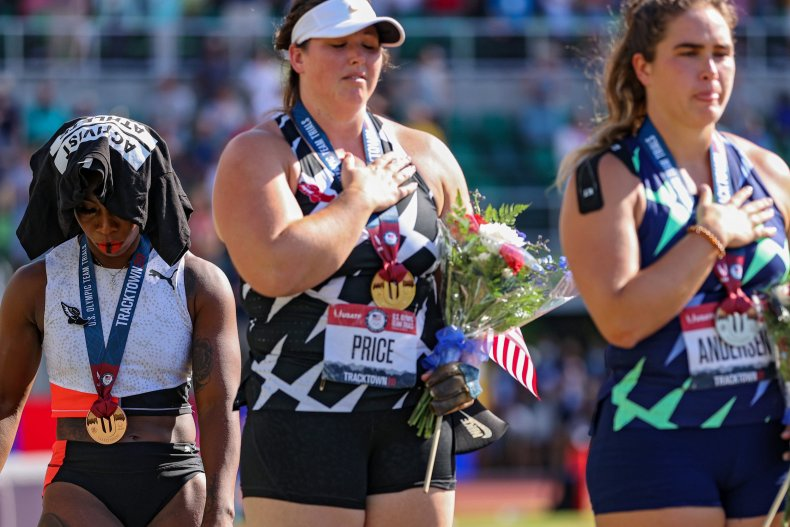 Gwen Barry turns away from US flag