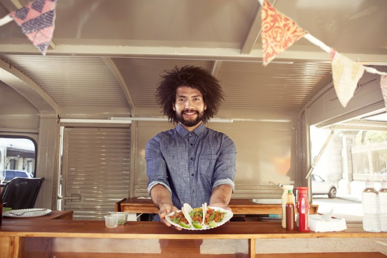 Stock image of a food truck worker.