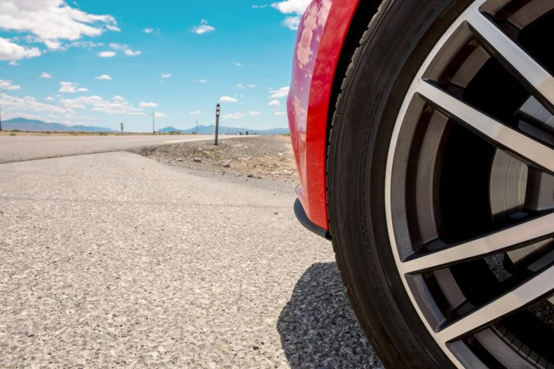 Car tire on a road