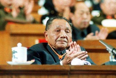 Chinese Paramount Leader Deng Xiaoping Applauds