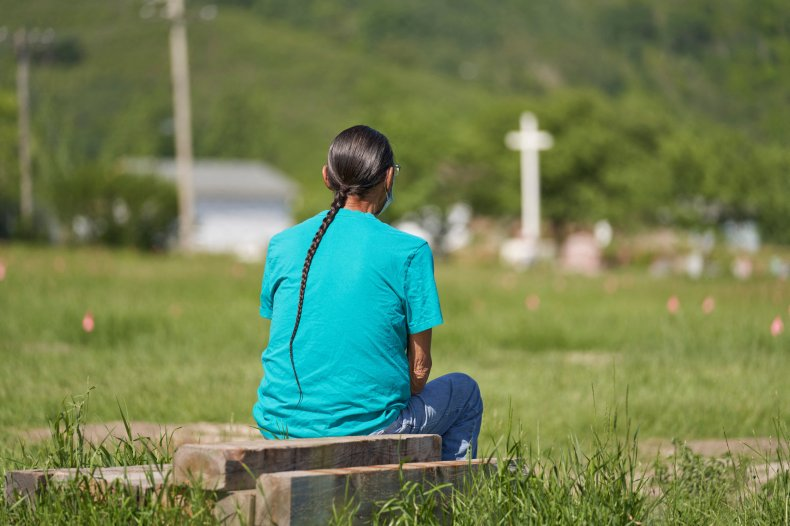 Man Sits and Prays over 750 Graves