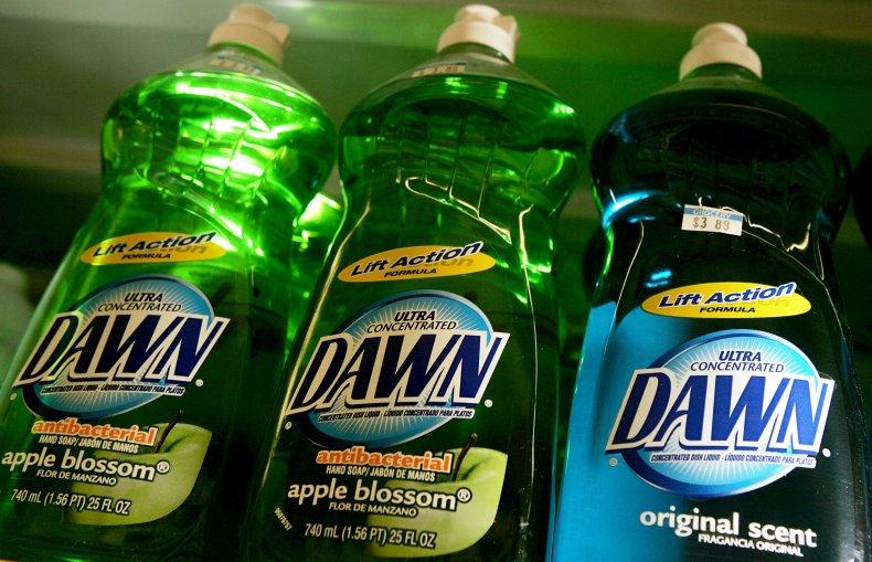 Bottles of Dawn dish soap on shelf.