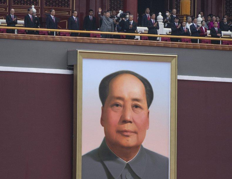 China's Xi Jinping Waves At Tiananmen Crowd