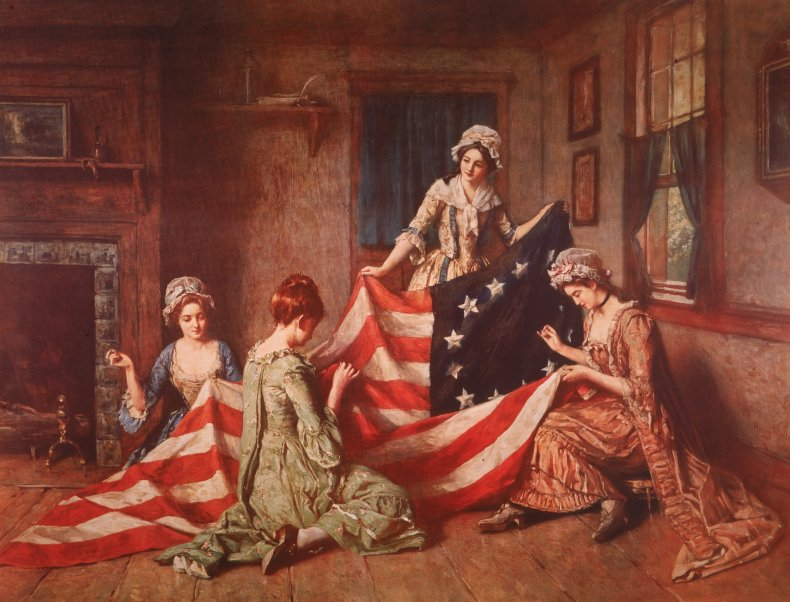 A painting of Betsy Ross sewing.