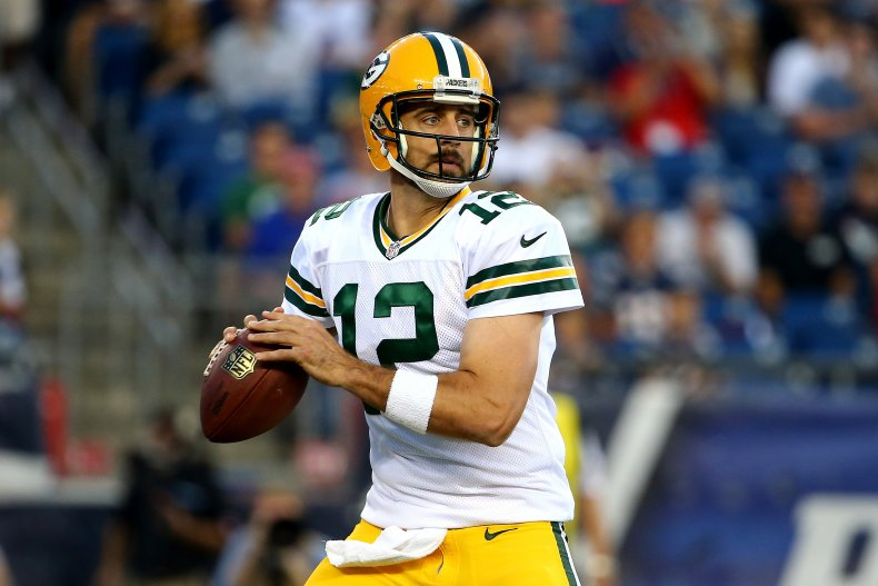 Aaron Rodgers of Packers v Patriots