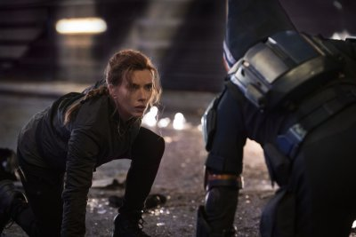 Scarlett Johansson as Black Widow fighting