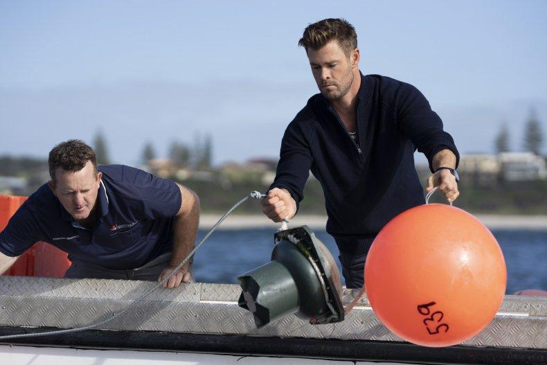 Chris Hemsworth investigating sharks