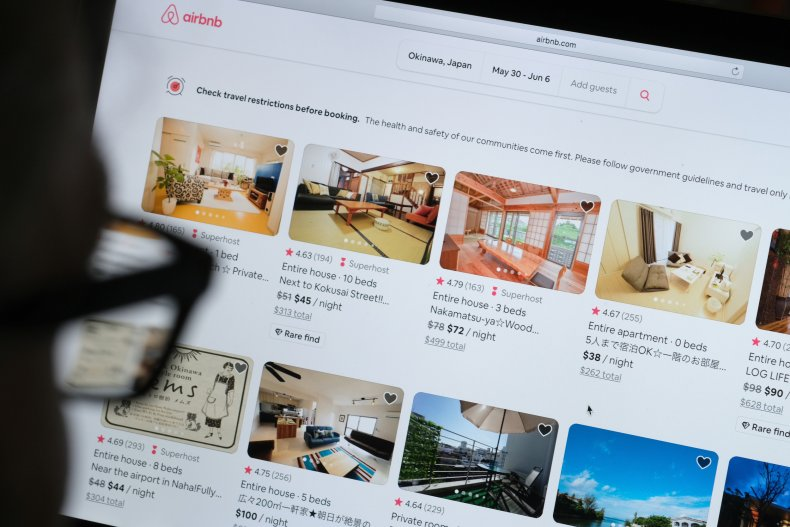 Airbnb adverts on a screen