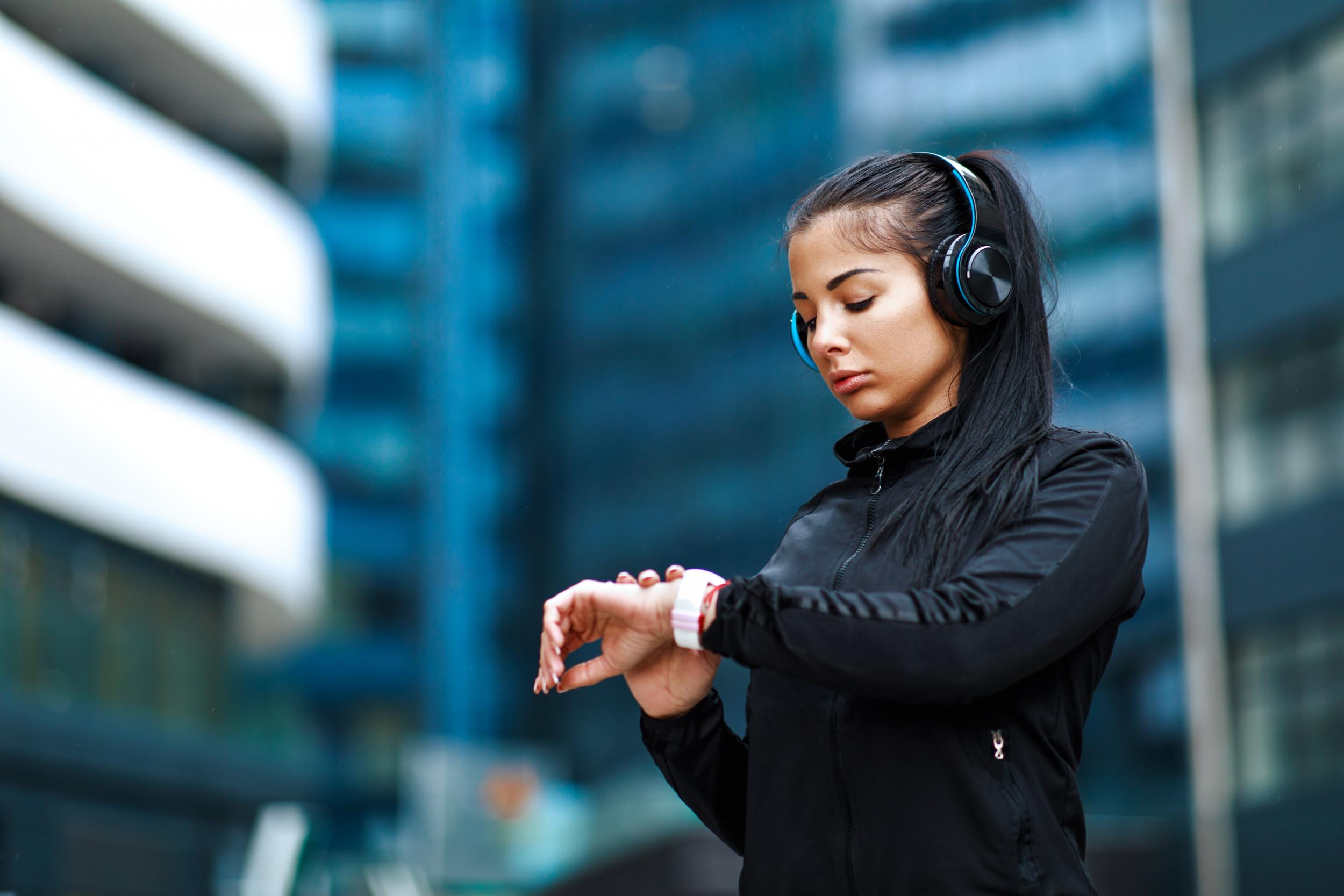 Woman looking smartwatch