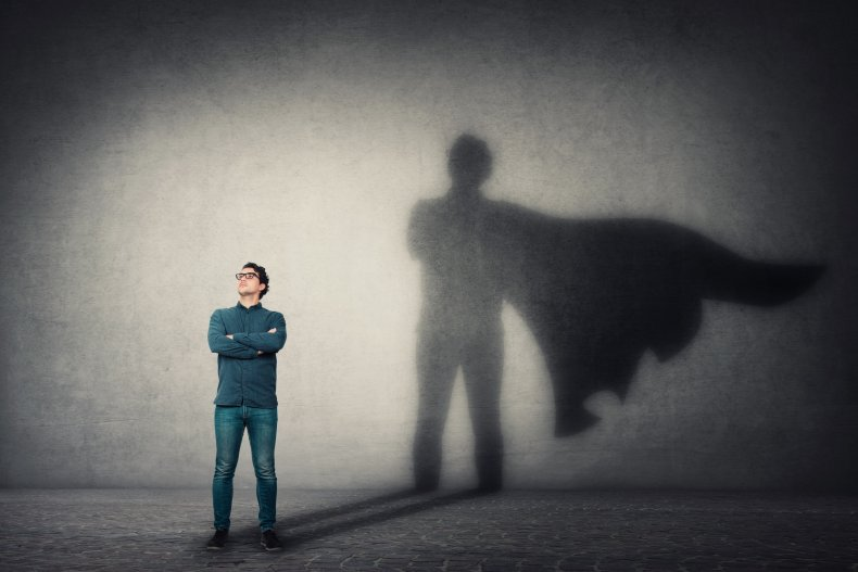 Man in suit with superhero shadow