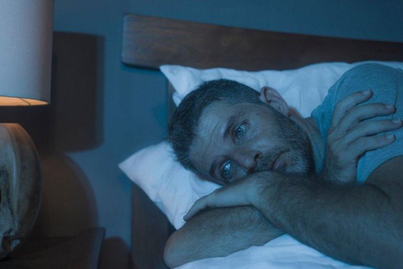 File photo of man struggling to sleep