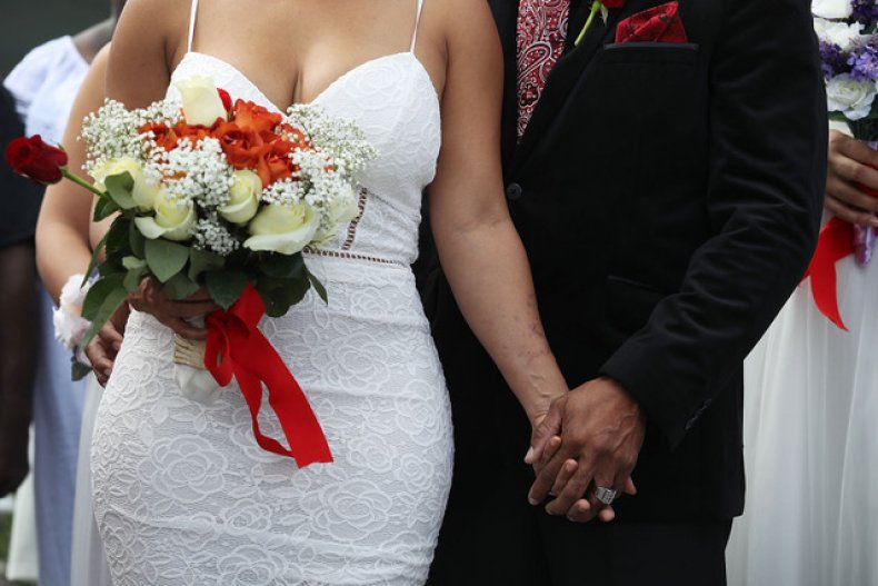 A Couple Participate in a Group Wedding