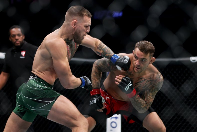 Conor McGregor attempts to punch Dustin Poirier.