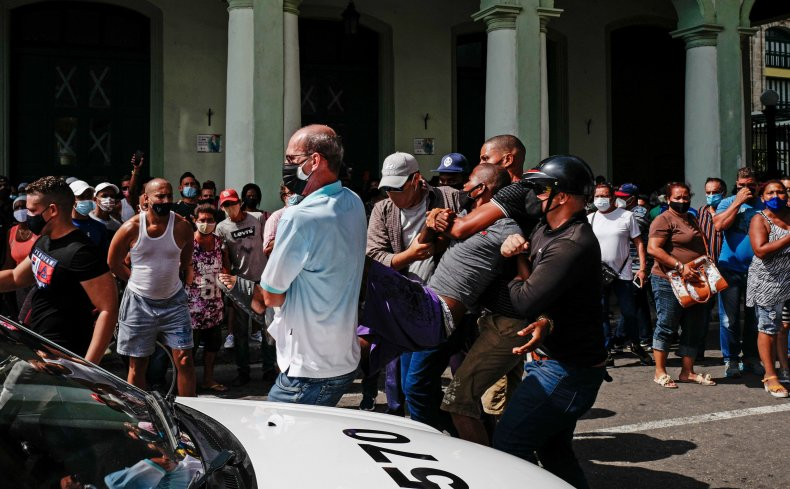 A man is arrested during a demonstration