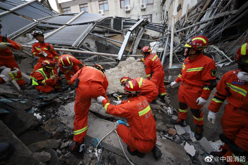 Firefighters Search For Survivors At Collapsed Hotel