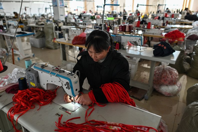 A worker sewing