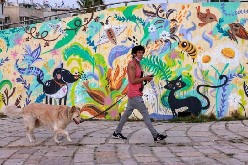 Woman Walks Dog in Tel Aviv